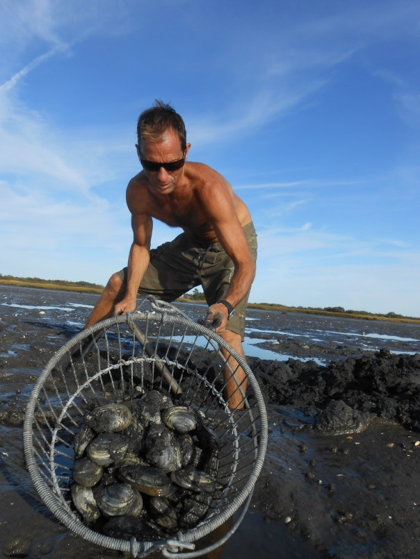 John digs clams as I dump over his bucket.