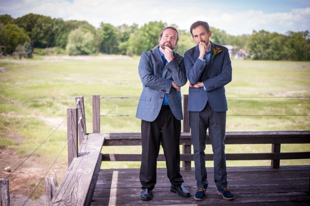 The officiant and the groom  want you to know that we know what you're up to. And we approve. Photo courtesy of Danita Jo Photography.